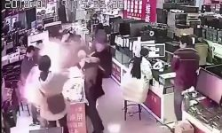 Top 9 Surveillance Videos of the Week: iPhone Battery Explodes in Man's Face After Biting It