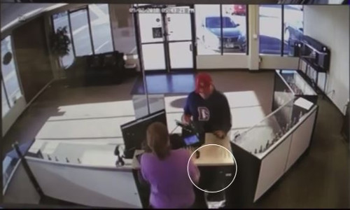 Top 9 Surveillance Videos of the Week: Clumsy Suspect Drops Gun, Botches Robbery