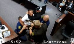 Read: Top 9 Surveillance Videos of the Week: Son Tries to Attack His Mom's Accused Killer in Court