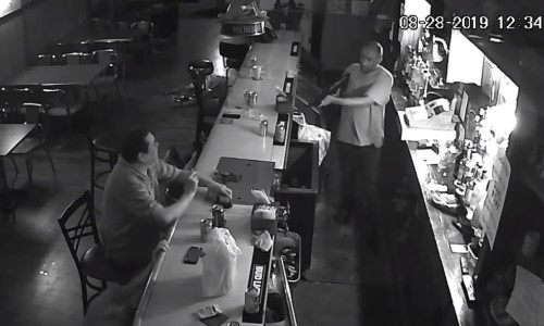 Top 9 Surveillance Videos of the Week: 'World's Chillest Man' Lights Cigarette During Armed Robbery