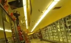 Top 9 Surveillance Videos of the Week: Man Falls Through Market Ceiling, Fires at Police